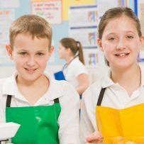 Schoolchildren at school in a cooking class
