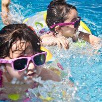 girls in pool, swimming in sunglasses, pool floaties