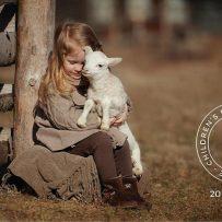 newmarket kids farm, girl holding a lamb
