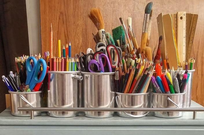 art and craft supplies, scissors, paint brushes, pencils