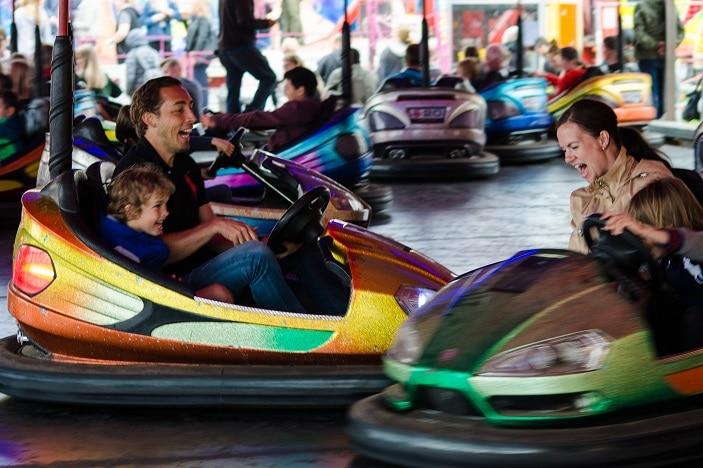 dodgem cars, school fete, rides, family riding in dodgem cars