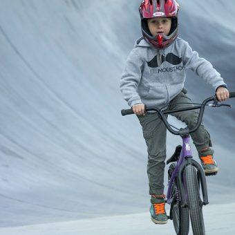 BMX boy riding bike at skate park