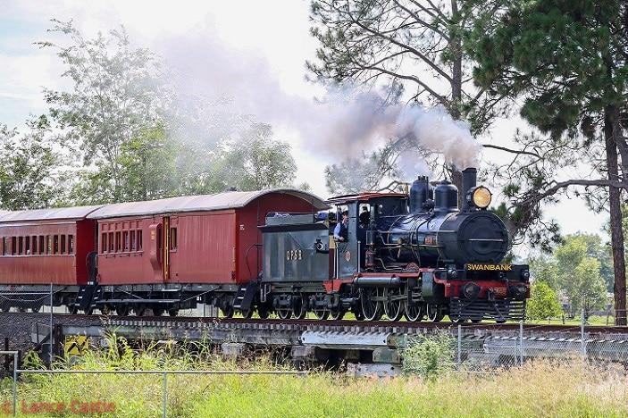 Queensland Pioneer Railway steam train, steam train driver, steam train ride through the countryside