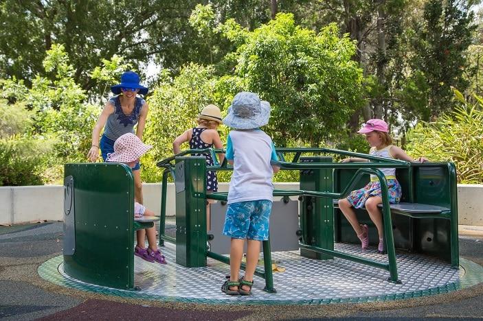 Children playing on playground equipment at City Botanic Gardens