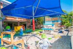 Sandpit under shade sails at childcare centre