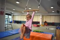 child on trapeze in pcyc