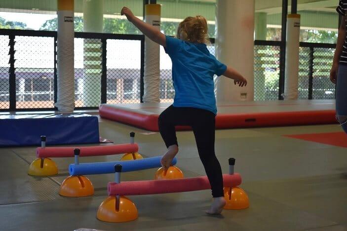 child balancing in gym room ptcyc