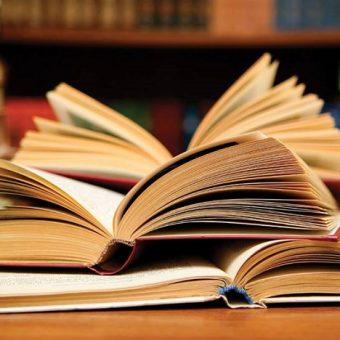 Lifeline Bookfest books, books on a desk, piles of books, open books
