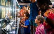 Kids looking at displays at Brisbane Planetarium. Photo supplied by Brisbane City Council