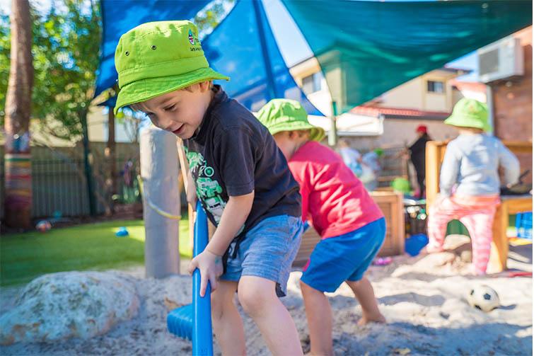 Children digging in sandpit at daycare
