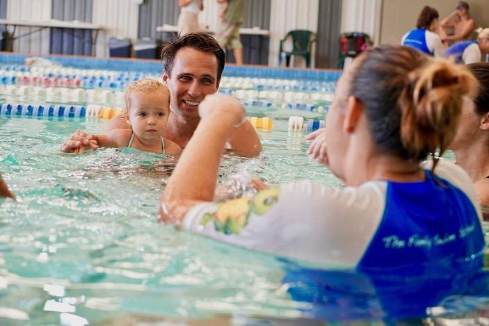 happy baby swimming