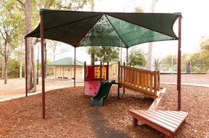 shaded playground DM Henderson Park