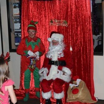 lighting of brisbane biggest christmas tree santa and his elf