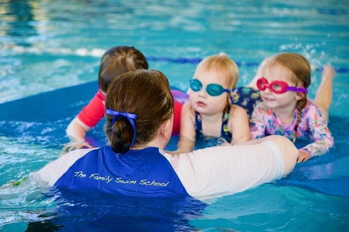 kids learning to swim