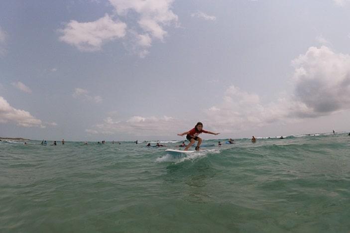 Girl surfing at Cylinder Beach