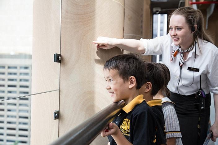 Museum of Brisbane young school children smiling