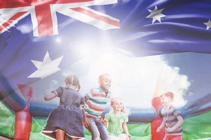 Australia Day Carpark, kids jumping on jumping castle, Australian flag