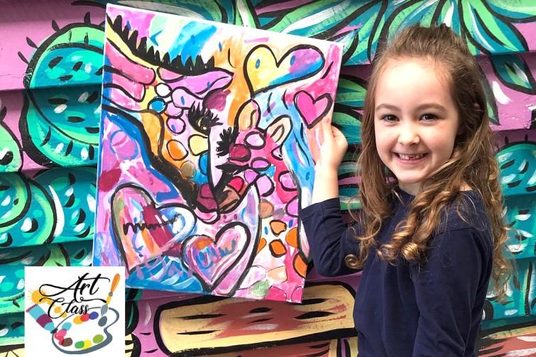Smiling girl displaying her artwork