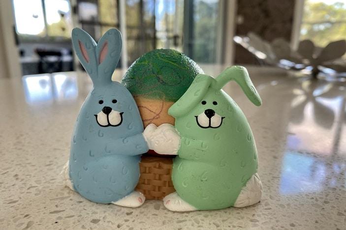 green egg in bunny holder