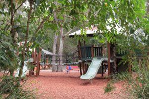 fort style playground iin amongst trees