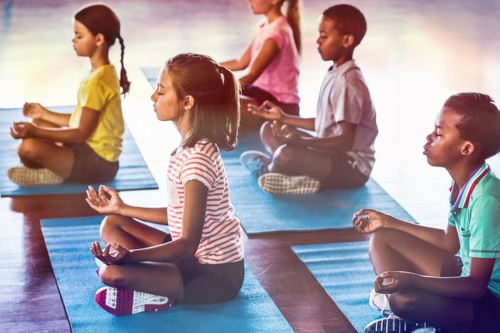 Tweens and teens practicing yoga