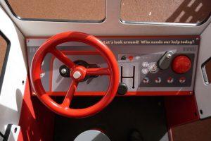red steering wheel plaay equipment