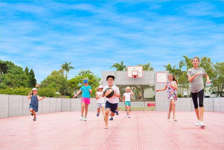 Kids on multi-purpose sports court at Brisbane Holiday Village