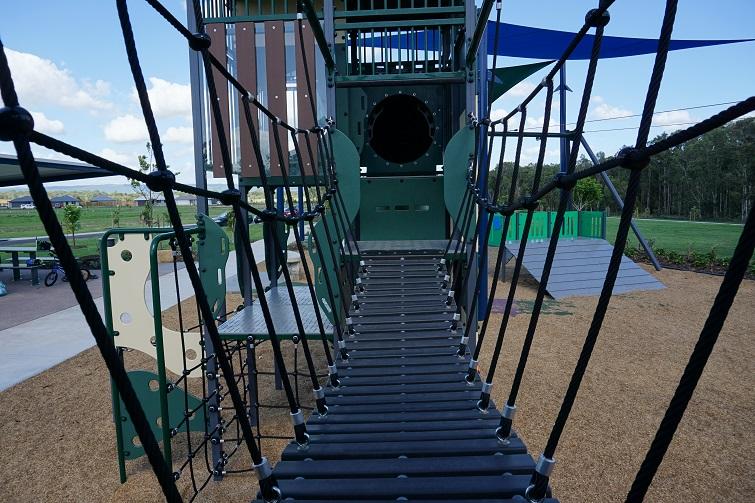 wobbly bridge with railings