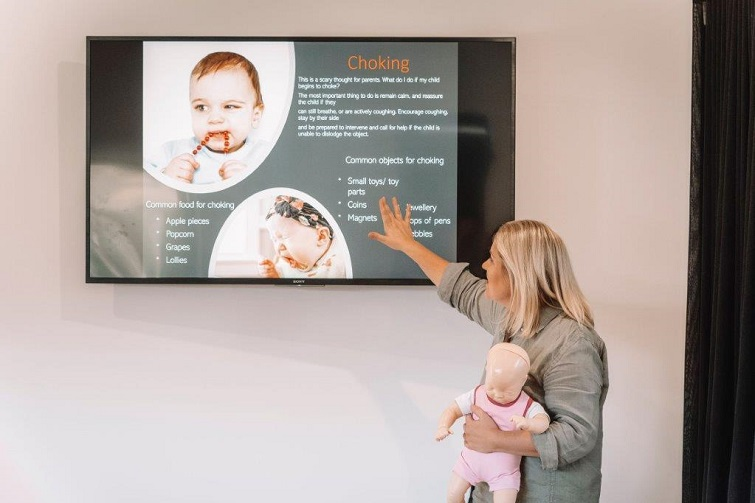 child first aid trainer in front of screen