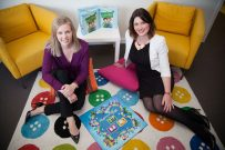 child counsellors sitting on floor smiling