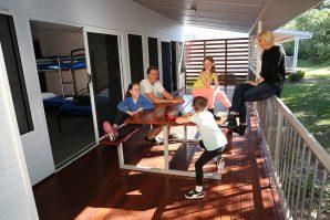 family having fun on verandah on holidays