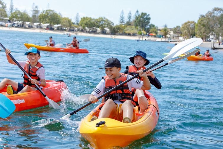 Kids in kayak wearing lifejackets