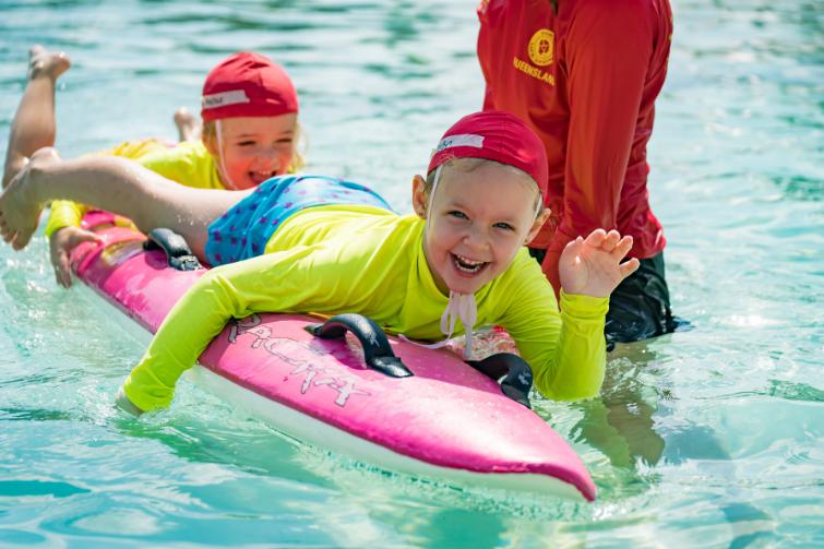 Little Lifesavers kids smiling on surf ski