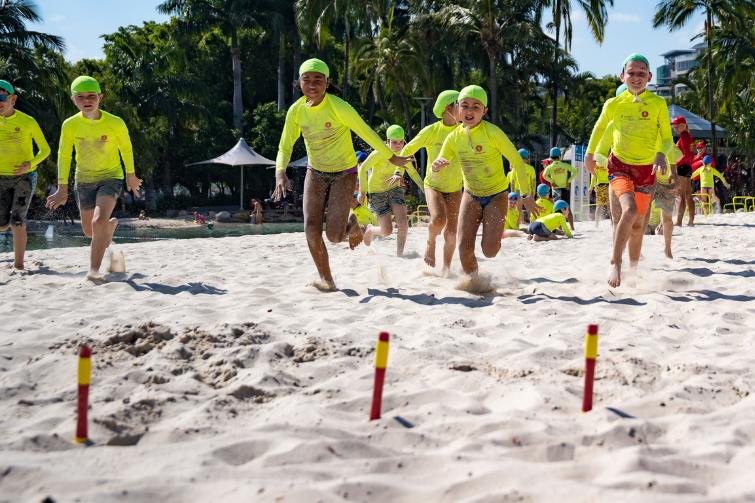 Little Lifesavers kids running on beach