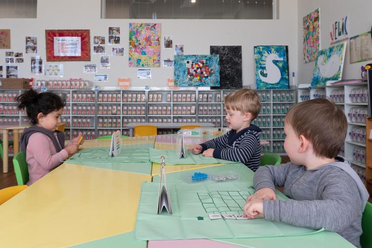 preschoolers working on activities at desk
