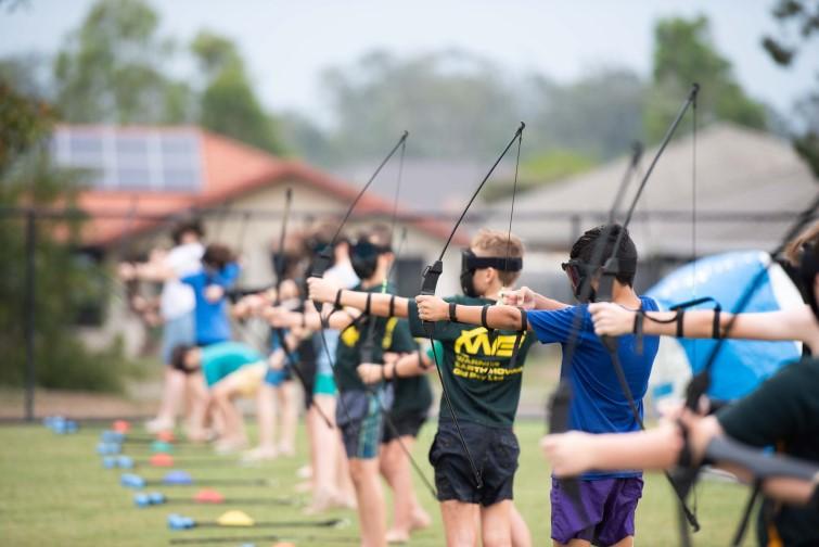 Children practising archery