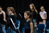 children performing on stage in choir