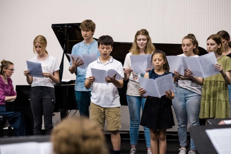 group of children singing in choir