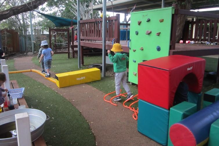 children playing outdoors at kindergarten