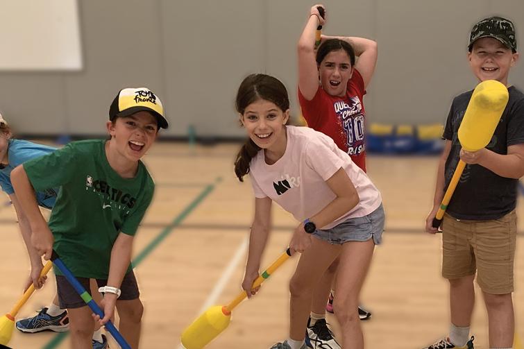 Children playing polo hockey