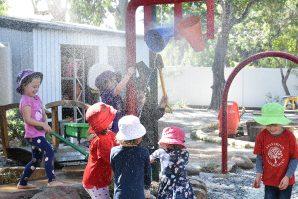 Children playing outdoors at Staverton Kindergarten