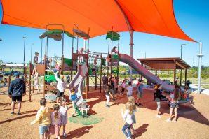 Children playing in the Village Green playground.