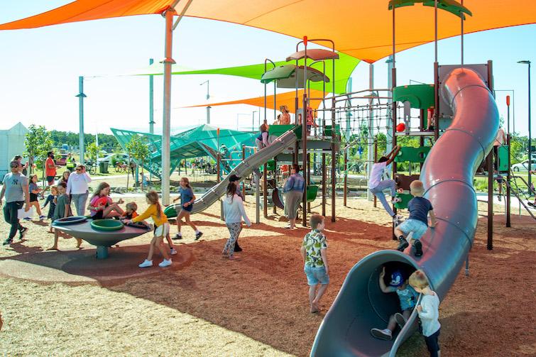 Lots of children in the Village Green playground.