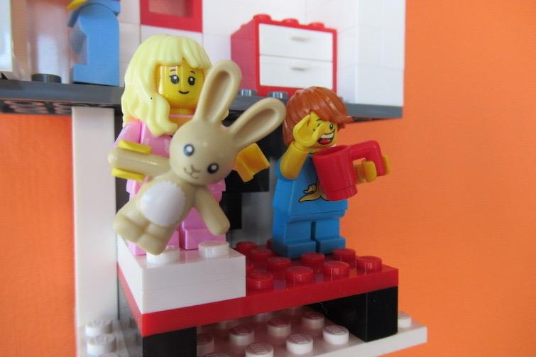 Lego mini figure holding bunny at Coffee n Bricks Cafe.